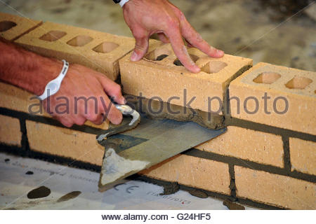 Embargoed to 0001 Tuesday May 24 File photo dated 06/10/11 of a trainee bricklayer. Bricklayers are being paid up - Stock Photo