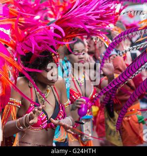 Portrait of dancing woman in costume on Carnival of Cultures  (Karneval der Kulturen)  in Berlin, Germany. - Stock Photo
