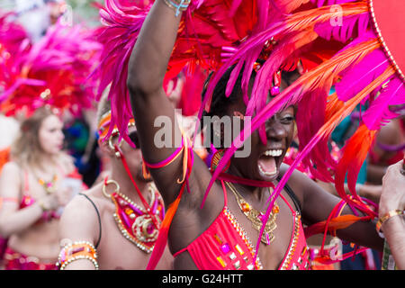 Portrait of dancing woman in costume on Carnival of Cultures  (Karneval der Kulturen)  in Berlin, Germany. - Stock Photo