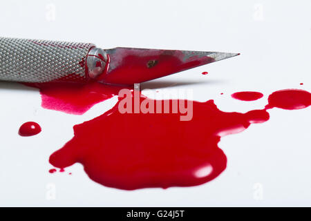 sharp scalpel knife and blood - Stock Photo