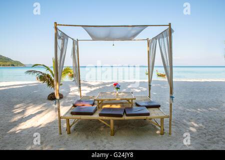 Romantic luxury dinner setting at tropical beach in Phuket, Thailand - Stock Photo
