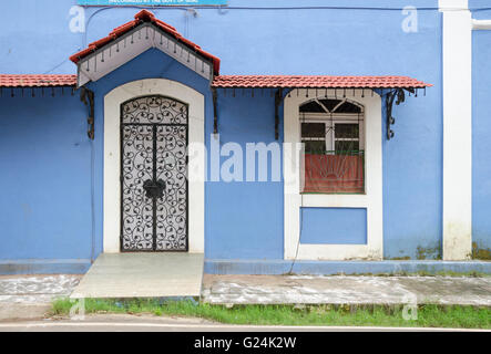 Facade of a typical traditional blue color Portuguese house with red colour tiled roof in Fontainhas, Panaji (Panjim), - Stock Photo