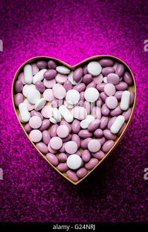 Generic pills and capsules in heart shape. - Stock Photo
