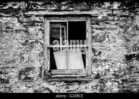 Old window in a stone wall - Stock Photo