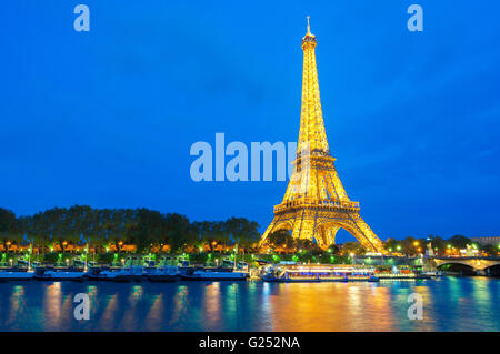 Beautiful view of illuminated Eiffel tower at dusk, Paris, France - Stock Photo