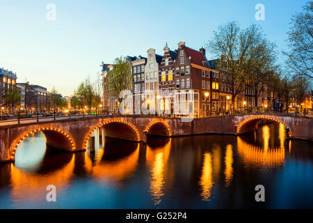 Wonderful view on houses of Amsterdam in night, Netherlands - Stock Photo