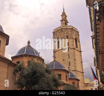 Micalet (Bell Tower) and blue domes of the Valencia Cathedral - Stock Photo