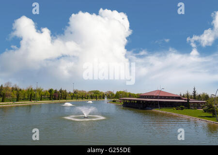 Landscape view of small lake around trees in Kentpark natural park in Eskisehir on blue sky background. - Stock Photo