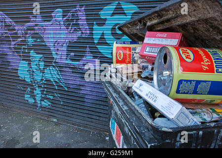 'no Dumping', Industrial cooking oil drums in waste bin by mural Camden town - Stock Photo