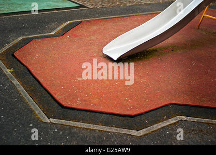 children's Slide on soft landing playground surface - Stock Photo
