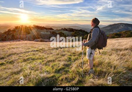Man hiking and looking at view, Vulcan Mountain Wilderness Preserve, California, America, USA - Stock Photo