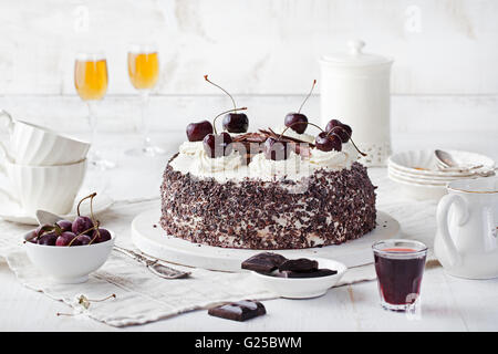 Black forest cake ,decorated with whipped cream and cherries Schwarzwald pie, dark chocolate and cherry dessert - Stock Photo
