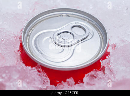 One Red Soda Can Packed in Ice. - Stock Photo