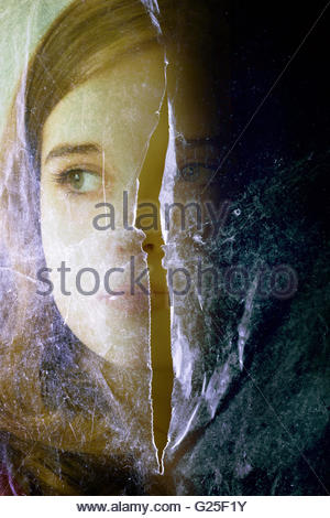 girl face behind a plastic sheet with a cut in the middle - Stock Photo