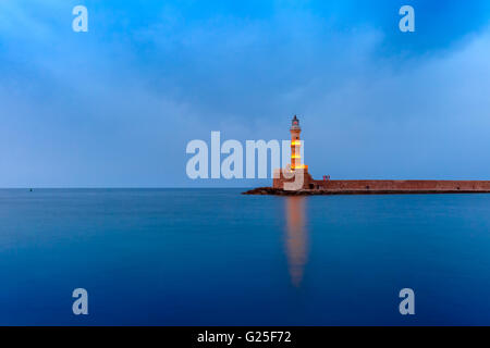 Night Lighthouse in old harbour, Chania, Crete - Stock Photo