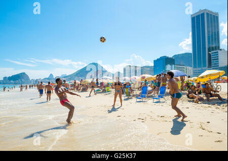 RIO DE JANEIRO - FEBRUARY 27, 2016: Young Brazilians play a game of altinho  football in a keepy uppy circle on - Stock Photo