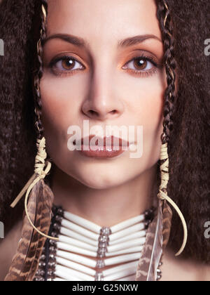 Woman wearing Native American accessories - Stock Photo
