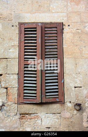 Old window in stone brick wall - Stock Photo