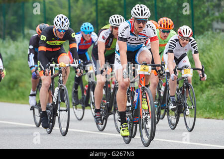 Cazis, Switzerland. May 24, 2016. Riders compete during the Criterium Race of the Cycling Grison Cup Series in Cazis. - Stock Photo