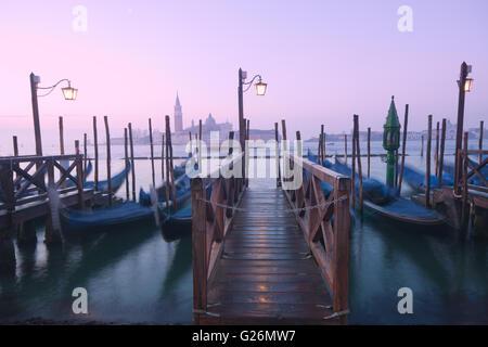 Venice, Italy - Traditional gondolas parked on Grand Canal - Stock Photo