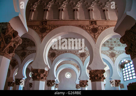 Toledo, Spain -   September 30, 2007: Mudejar archs from Synagogue Santa Maria la Blanca. Construction date sometime - Stock Photo