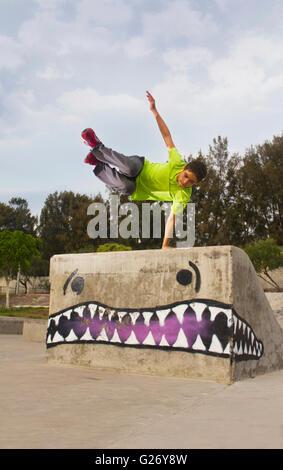 Parkour jump teenager in skate park - Stock Photo