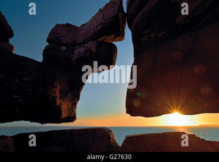 Portugal: Silhouette of  curious rock formation and scenic sunset  at Cape Carvoeiro - Stock Photo