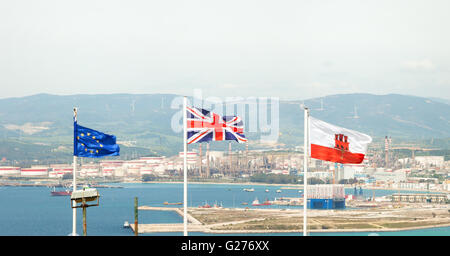 Flags of the EU, the UK and Gibraltar flying on the Rock of Gibraltar, Gibraltar, Europe - Stock Photo