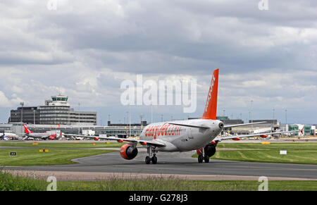 Easyjet Airbus A320-214 airliner approaching terminal at Manchester International Airport - Stock Photo