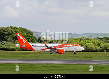 Easyjet Airbus A320-214 airliner taxiing at Manchester International Airport - Stock Photo
