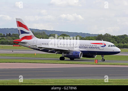 British Airways Airbus A319-131 airliner taxiing at Manchester International Airport - Stock Photo