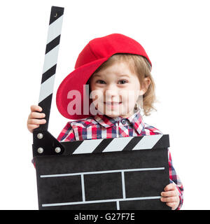 child girl holding clapper board in hands isolated - Stock Photo