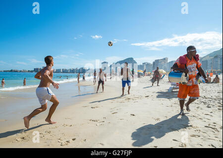 RIO DE JANEIRO - FEBRUARY 27, 2016: Young Brazilians play a game of altinho beach football on the shore of Copacabana - Stock Photo
