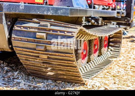 Emmaboda, Sweden - May 13, 2016: Forest and tractor (Skog och traktor) fair. Close up of crawler tracks on forest - Stock Photo