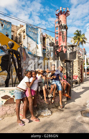 A group of young Cuban children who live in and around Hamel's Alley in Havana La Habana, Cuba pose for the camera. - Stock Photo