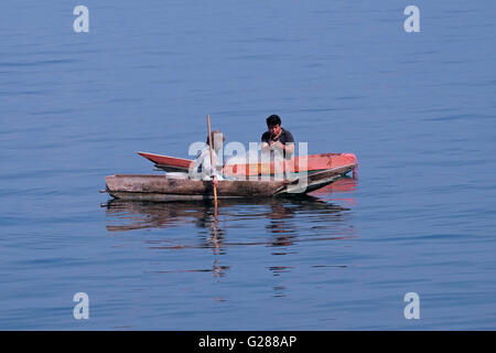 Fishermen boating at the shore of Lake Atitlan near the village of San Antonio in the Guatemalan Highlands of the - Stock Photo