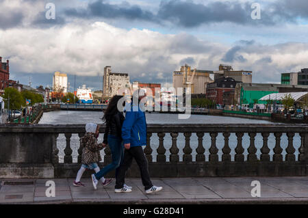 A family cross Bridge over River, Cork city, county Cork, Ireland - Stock Photo