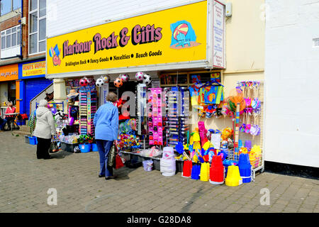 BRIDLINGTON, YORKSHIRE, UK. MAY 11, 2016. A retail shop on the harbor quay selling beach and holiday essentials - Stock Photo