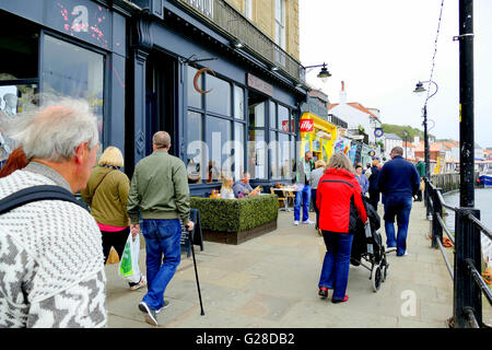 WHITBY, YORKSHIRE, UK. MAY 12, 2016.  A busy quayside on the banks of the river 'Esk' at Whitby in North Yorkshire, - Stock Photo