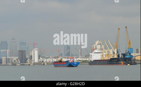 Ships on the River Thames in East London - Stock Photo