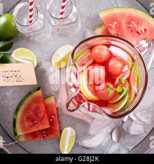 Watermelon drink with lime in a pitcher - Stock Photo