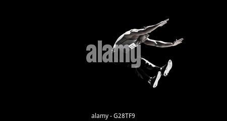 Portrait of sportsman jumping - Stock Photo
