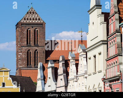 St. Nikolai church and facades in street Krämerstrasse, Wismar, Germany - Stock Photo