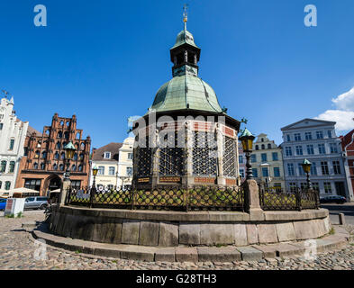 'Wasserkunst', water well, Historic downtown, marktplatz, market place, town square,  Wismar, Germany. - Stock Photo