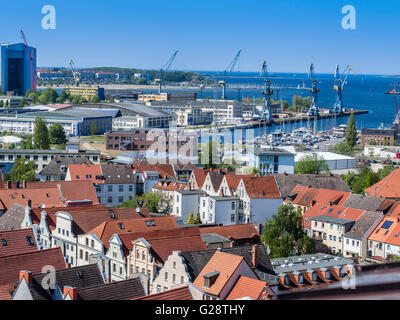 Cranes at the harbor, seen from platform of St. Georgen church, Wismar, Germany. - Stock Photo