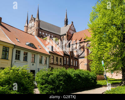 St. Georgen church, seen from park area at Fuerstenhof, Wismar, Mecklenburg-Vorpommern, Germany - Stock Photo