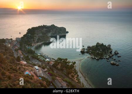 Isola Bella (Beautiful Island) at sunrise, near Taormina, in Sicily, Italy - Stock Photo