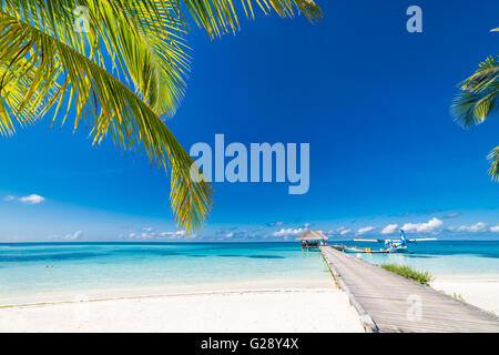 Amazing beach in Maldives with luxury water villas. Exotic background concept. - Stock Photo