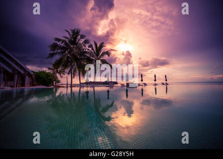 Amazing sunset beach in Maldives. Background concept - Stock Photo