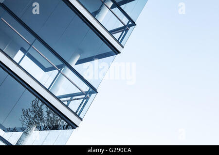 Abstract fragment of contemporary architecture, walls made of glass and concrete floors. Blue tonal filter photo - Stock Photo
